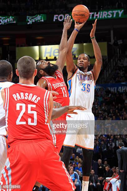 Kevin Durant of the Oklahoma City Thunder shoots over James Harden of the Houston Rockets during an NBA game on December 29 2013 at the Chesapeake...