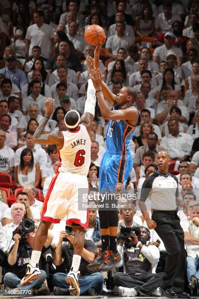 Kevin Durant of the Oklahoma City Thunder shoots over LeBron James of the Miami Heat during Game Five of the 2012 NBA Finals at American Airlines...