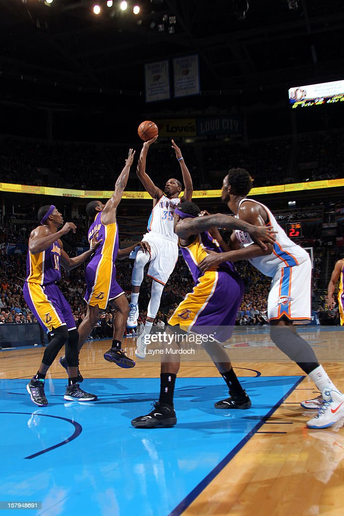 Kevin Durant #35 of the Oklahoma City Thunder shoots over the Los Angeles Lakers during an NBA game on December 7, 2012 at the Chesapeake Energy Arena in Oklahoma City, Oklahoma.