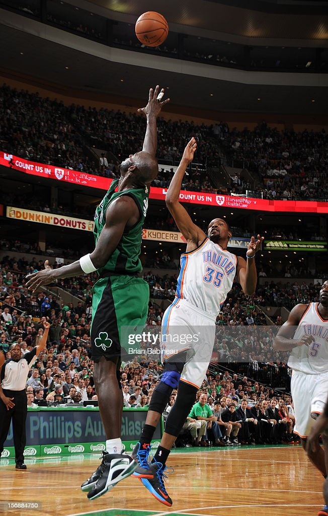 Kevin Durant #35 of the Oklahoma City Thunder shoots the ball against Kevin Garnett #5 of the Boston Celtics on November 23, 2012 at the TD Garden in Boston, Massachusetts.