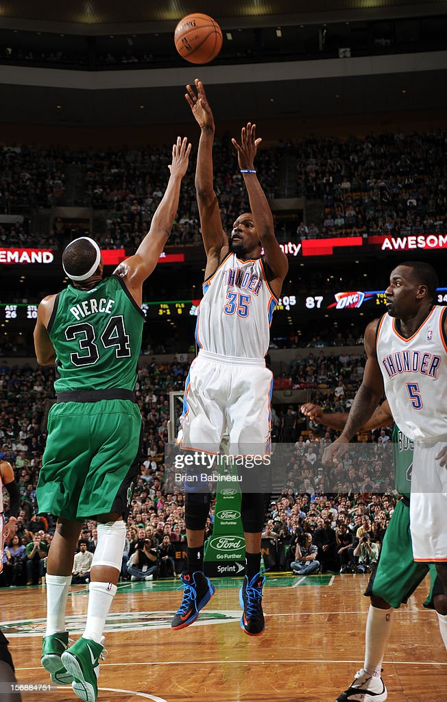 Kevin Durant #35 of the Oklahoma City Thunder shoots the ball against Paul Pierce #34 of the Boston Celtics on November 23, 2012 at the TD Garden in Boston, Massachusetts.
