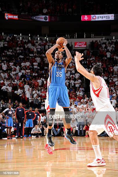Kevin Durant of the Oklahoma City Thunder shoots the ball against Carlos Delfino of the Houston Rockets in Game Three of the Western Conference...