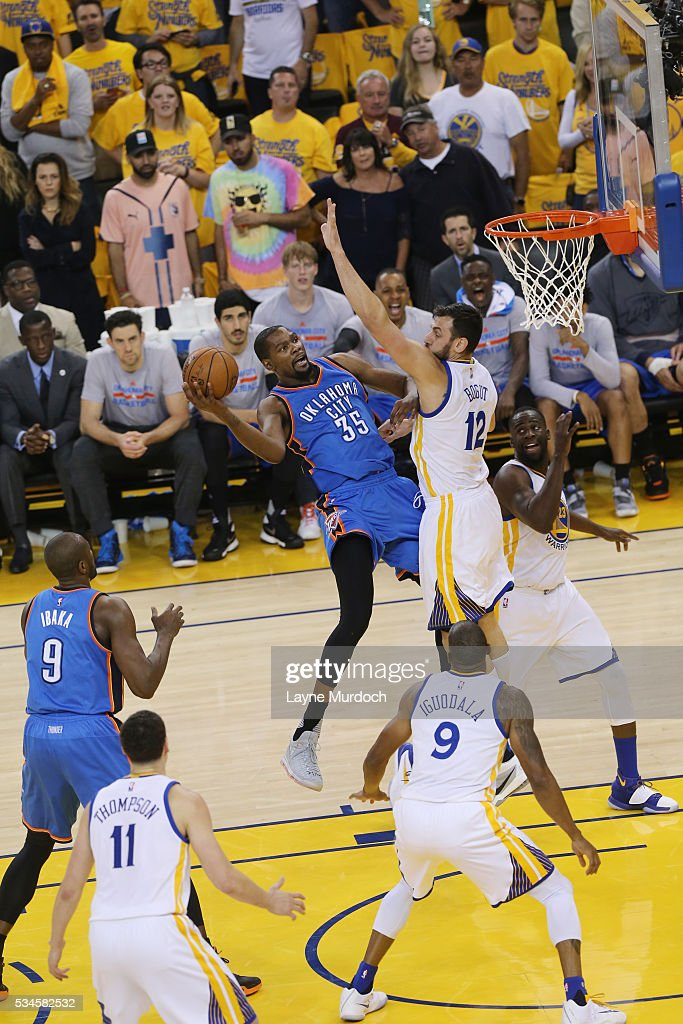 <a gi-track='captionPersonalityLinkClicked' href=/galleries/search?phrase=Kevin+Durant&family=editorial&specificpeople=3847329 ng-click='$event.stopPropagation()'>Kevin Durant</a> #35 of the Oklahoma City Thunder shoots the ball against the Golden State Warriors in Game Five of the Western Conference Finals during the 2016 NBA Playoffs on May 26, 2016 at ORACLE Arena in Oakland, California.