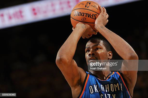 Kevin Durant of the Oklahoma City Thunder shoots the ball against the Golden State Warriors in Game Seven of the Western Conference Finals during the...