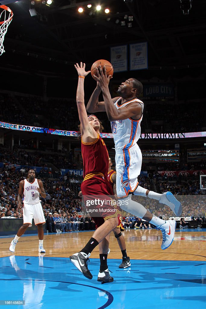 <a gi-track='captionPersonalityLinkClicked' href=/galleries/search?phrase=Kevin+Durant&family=editorial&specificpeople=3847329 ng-click='$event.stopPropagation()'>Kevin Durant</a> #35 of the Oklahoma City Thunder shoots the ball vs the Cleveland Cavaliers during an NBA game on November 11, 2012 at the Chesapeake Energy Arena in Oklahoma City, Oklahoma.