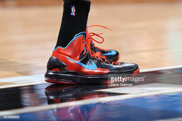 Kevin Durant of the Oklahoma City Thunder shows off his sneakers during the game against the Minnesota Timberwolves on March 29 2013 at Target Center...