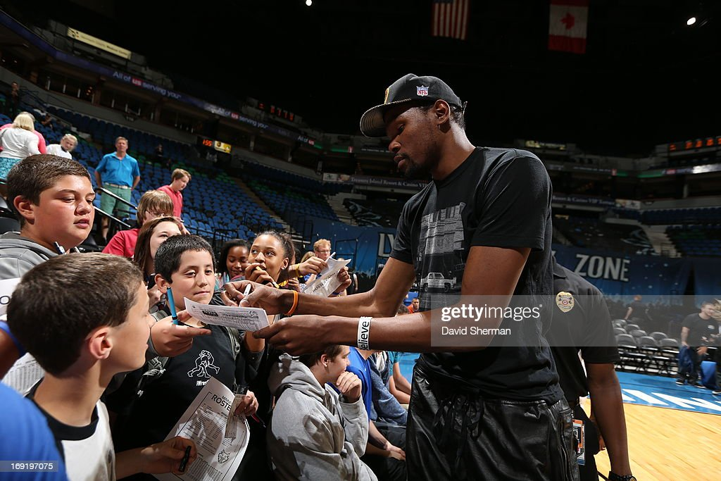 Kevin Durant #35 of the Oklahoma City Thunder signs autographs after the Minnesota Lynx played against the Connecticut Sun during the WNBA pre-season game on May 21, 2013 at Target Center in Minneapolis, Minnesota.
