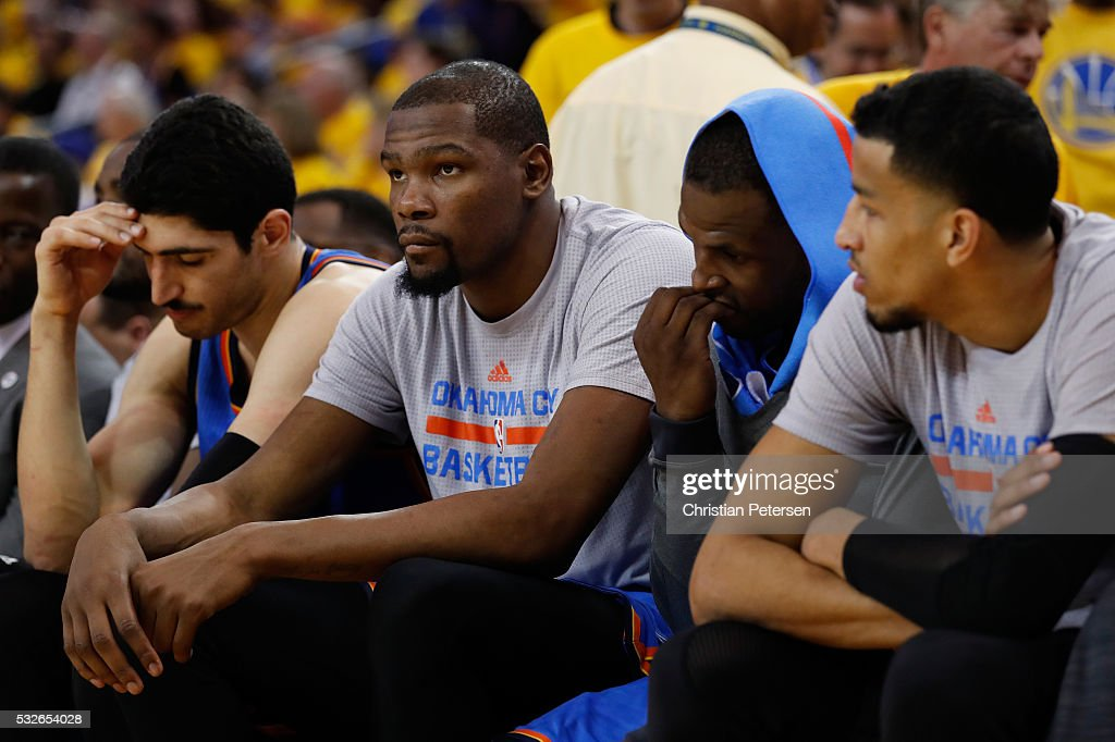 Kevin Durant of the Oklahoma City Thunder sits on the bench with his teammates in the fourth quarter of game two of the Western Conference Finals...