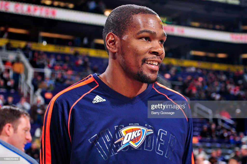 Kevin Durant #35 of the Oklahoma City Thunder smiles before a game against the Phoenix Suns on January 14, 2013 at U.S. Airways Center in Phoenix, Arizona.