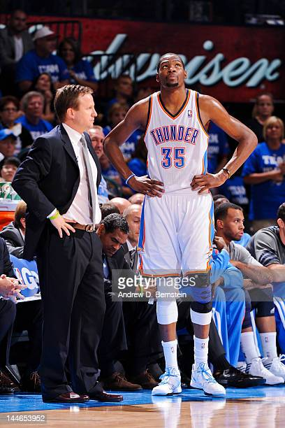 Kevin Durant of the Oklahoma City Thunder speaks to head coach Scott Brooks while playing against the Los Angeles Lakers in Game Two of the Western...