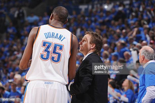 Kevin Durant of the Oklahoma City Thunder speaks with head coach Scott Brooks during the game against the Los Angeles Lakers in Game Six of the...