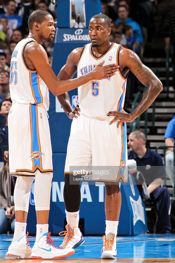 Kevin Durant #35 of the Oklahoma City Thunder speaks with teammate Kendrick Perkins #5 during a game against the Minnesota Timberwolves on February 22, 2013 at the Chesapeake Energy Arena in Oklahoma City, Oklahoma.