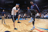 Kevin Durant of the Oklahoma City Thunder stretches before Game Four of the Western Conference Finals against the Golden State Warriors during the...