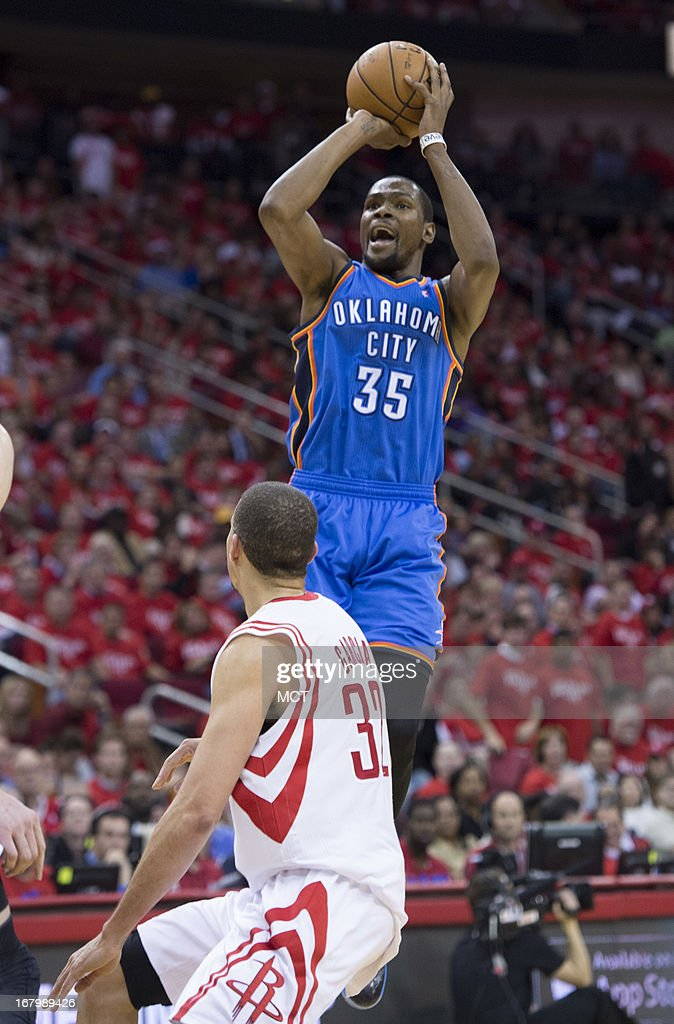 Kevin Durant (35) of the Oklahoma City Thunder takes a shot against Francisco Garcia (32) of the Houston Rockets in the second half of their Western Conference playoff game game on Friday, May 3, 2013, in Houston, Texas.