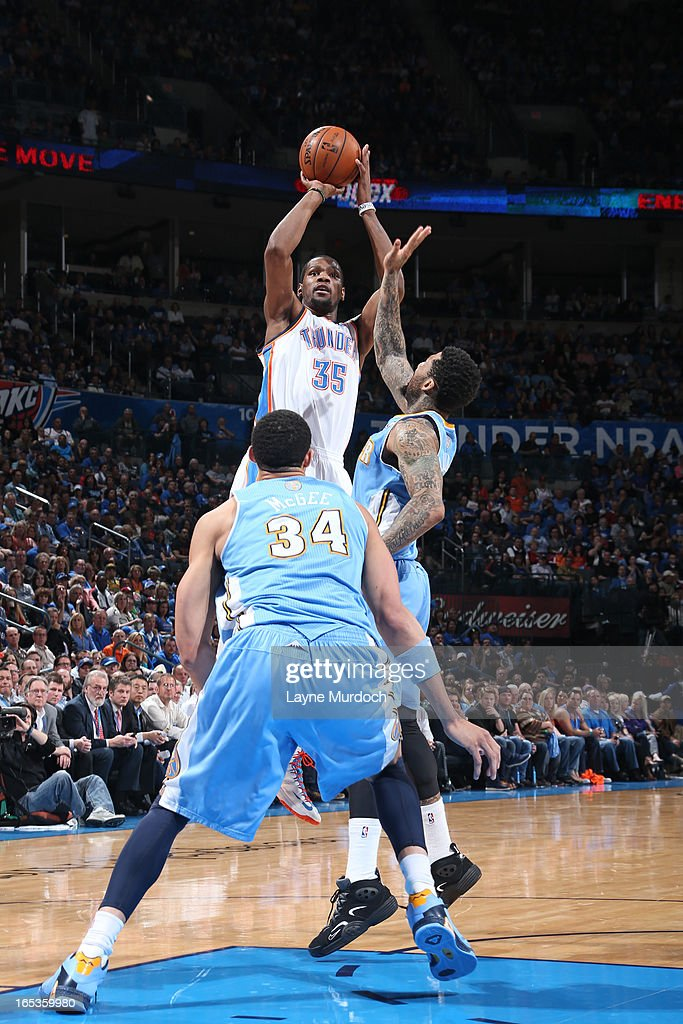 Kevin Durant #35 of the Oklahoma City Thunder takes a shot against the Denver Nuggets on March 19, 2013 at the Chesapeake Energy Arena in Oklahoma City, Oklahoma.