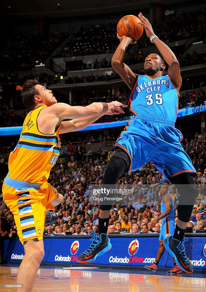 Kevin Durant #35 of the Oklahoma City Thunder takes a shot and is fouled by Danilo Gallinari #8 of the Denver Nuggets at the Pepsi Center on January 20, 2013 in Denver, Colorado.