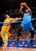 Kevin Durant of the Oklahoma City Thunder takes a shot and is fouled by Danilo Gallinari of the Denver Nuggets at the Pepsi Center on January 20 2013...