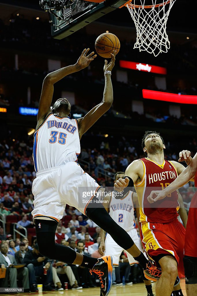 Kevin Durant #35 of the Oklahoma City Thunder takes a shot over Chandler Parsons #25 of the Houston Rockets at Toyota Center on February 20, 2013 in Houston, Texas.