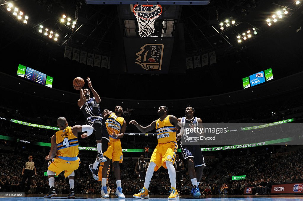 <a gi-track='captionPersonalityLinkClicked' href=/galleries/search?phrase=Kevin+Durant&family=editorial&specificpeople=3847329 ng-click='$event.stopPropagation()'>Kevin Durant</a> #35 of the Oklahoma City Thunder taking a shot during a game against the Denver Nuggets on January 9, 2014 at the Pepsi Center in Denver, Colorado.