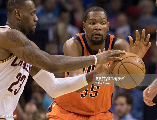 Kevin Durant of the Oklahoma City Thunder tries to keep the ball away from LeBron James of the Cleveland Cavaliers during the third quarter of a NBA...