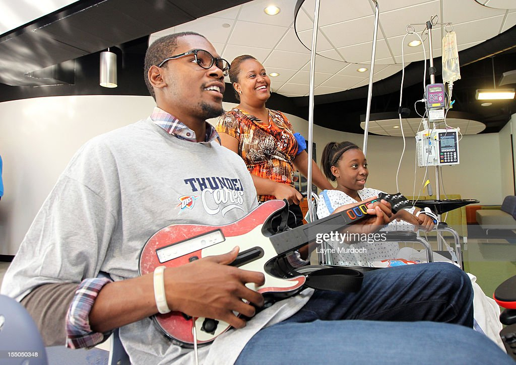 <a gi-track='captionPersonalityLinkClicked' href=/galleries/search?phrase=Kevin+Durant&family=editorial&specificpeople=3847329 ng-click='$event.stopPropagation()'>Kevin Durant</a> of the Oklahoma City Thunder visits patients in the Children's Hospital on October 30, 2012 in Oklahoma City, Oklahoma.