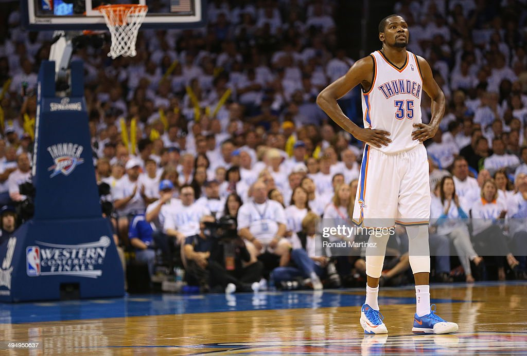 <a gi-track='captionPersonalityLinkClicked' href=/galleries/search?phrase=Kevin+Durant&family=editorial&specificpeople=3847329 ng-click='$event.stopPropagation()'>Kevin Durant</a> #35 of the Oklahoma City Thunder waits on the court in the second half against the San Antonio Spurs during Game Six of the Western Conference Finals of the 2014 NBA Playoffs at Chesapeake Energy Arena on May 31, 2014 in Oklahoma City, Oklahoma.
