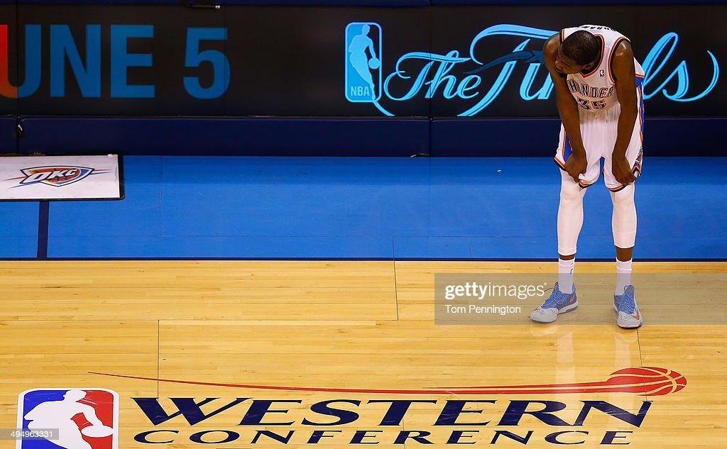 Kevin Durant of the Oklahoma City Thunder waits on the court in the overtime period against the San Antonio Spurs during Game Six of the Western...