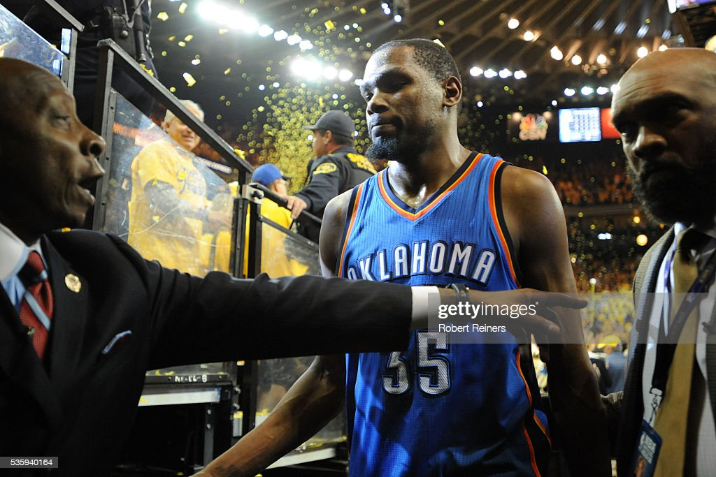 Kevin Durant of the Oklahoma City Thunder walks off the court after being defeated 9688 by the Golden State Warriors in Game Seven of the Western...
