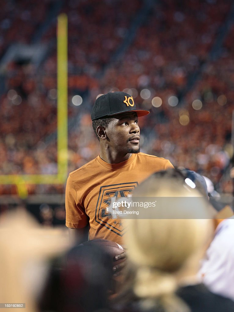 Kevin Durant of the Oklahoma City Thunder walks the Texas Longhorns sidelines during the game against the Oklahoma State Cowboys on September 29, 2012 at Boone Pickens Stadium in Stillwater, Oklahoma. Texas defeated Oklahoma State 41-36.