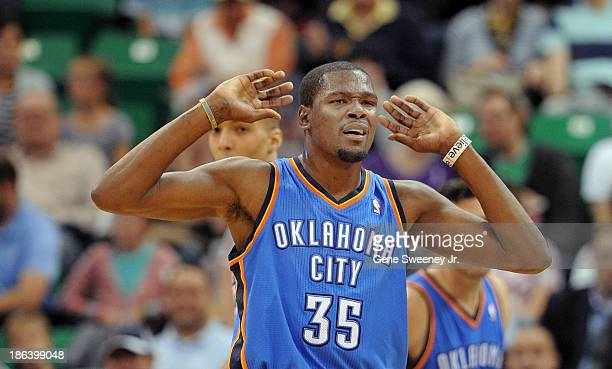 Kevin Durant of the Oklahoma City Thunder who was the leading scorer in their game against the Utah Jazz with 42 points listens to head coach Scott...