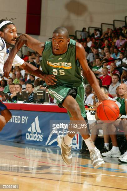 Kevin Durant of the Seattle SuperSonics dribbles by Renaldo Balkman of the New York Knicks during the NBA Summer League on July 9 2007 at the Cox...