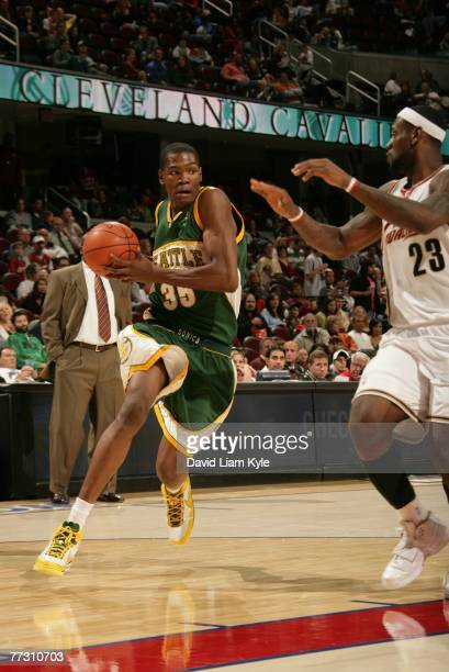 Kevin Durant of the Seattle SuperSonics drives to the hoop against Lebron James of the Cleveland Cavaliers at The Quicken Loans Arena October 12 2007...