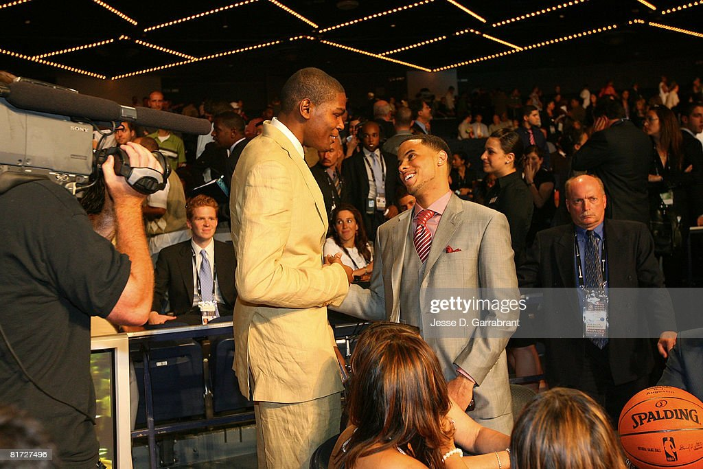 Kevin Durant #35 of the Seattle Supersonics greets NBA Draft prospect D.J. Augustin in the green room prior to the 2008 NBA Draft on June 26, 2008 at the WaMu Theatre at Madison Square Garden in New York City.