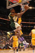 Kevin Durant of the Seattle Supersonics puts up a reverselayup against Lamar Odom of the Los Angeles Lakers during the second quarter of their game...