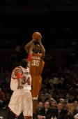 Kevin Durant of the Texas Longhorns takes a jump shot against St John's Redstorm on November 17 2006 during the 2K Sports College Hoops Classic at...