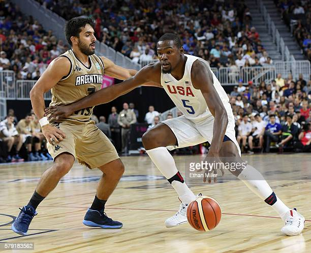 Kevin Durant of the United States drives against Facundo Campazzo of Argentina during a USA Basketball showcase exhibition game at TMobile Arena on...