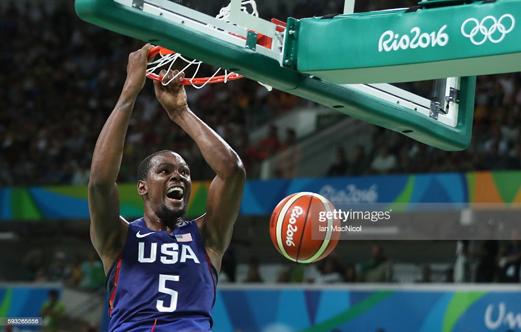 Kevin Durant of the United states slam dunks during the final match of the Men's basketball between Serbia and United States on day 16 at Carioca...