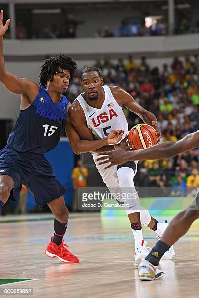Kevin Durant of the USA Basketball Men's National Team drives to the basket against Mickael Gelabale of France on Day 9 of the Rio 2016 Olympic Games...