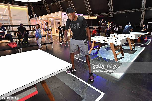 Kevin Durant of the USA Basketball Men's National Team plays ping pong while visiting the Team Nike House during the Rio 2016 Olympic Games on August...