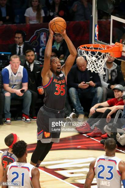 Kevin Durant of the Western Conference AllStar Team dunks the ball during the game against the Eastern Conference AllStar Team during the NBA AllStar...