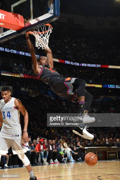 Kevin Durant of the Western Conference AllStar Team dunks the ball against the Eastern Conference AllStar Team during the NBA AllStar Game as part of...