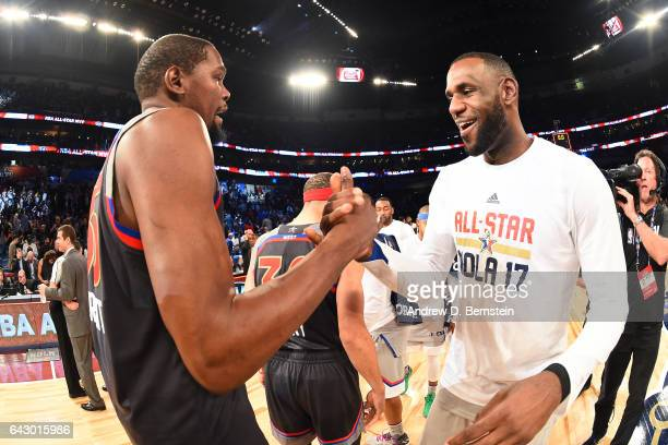 Kevin Durant of the Western Conference AllStar Team shakes hands with LeBron James of the Eastern Conference AllStar Team after the NBA AllStar Game...
