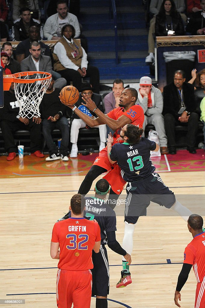 <a gi-track='captionPersonalityLinkClicked' href=/galleries/search?phrase=Kevin+Durant&family=editorial&specificpeople=3847329 ng-click='$event.stopPropagation()'>Kevin Durant</a> #35 of the Western Conference All-Stars shoots against <a gi-track='captionPersonalityLinkClicked' href=/galleries/search?phrase=Joakim+Noah&family=editorial&specificpeople=699038 ng-click='$event.stopPropagation()'>Joakim Noah</a> #13 of the Eastern Conference All-Stars during the 2014 NBA All-Star Game at Smoothie King Center on February 16, 2014 in New Orleans, Louisiana.