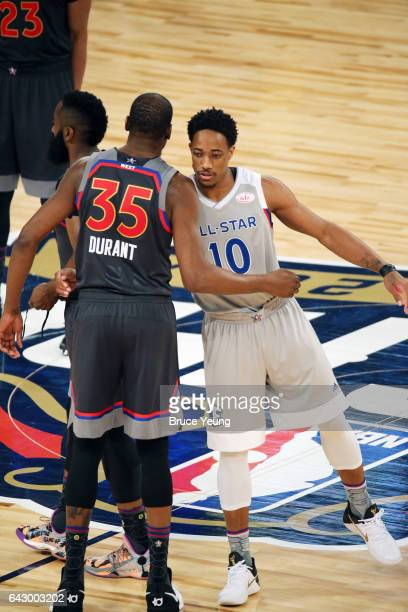 Kevin Durant of the Western Conference greets DeMar DeRozan of the Eastern Conference before the game during the NBA AllStar Game as part of the 2017...