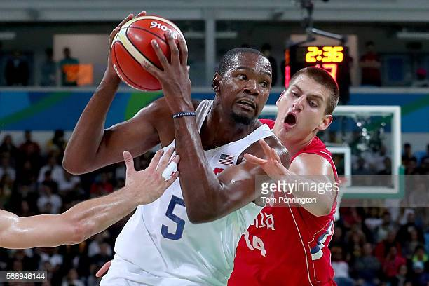 Kevin Durant of United States goes to the basket against Nikola Jokic of Serbia in the Men's Preliminary Round Group A match on Day 7 of the Rio 2016...