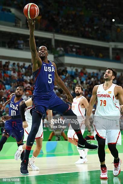 Kevin Durant of United States goes to the basket against Ricky Rubio of Spain during the Men's Semifinal match on Day 14 of the Rio 2016 Olympic...