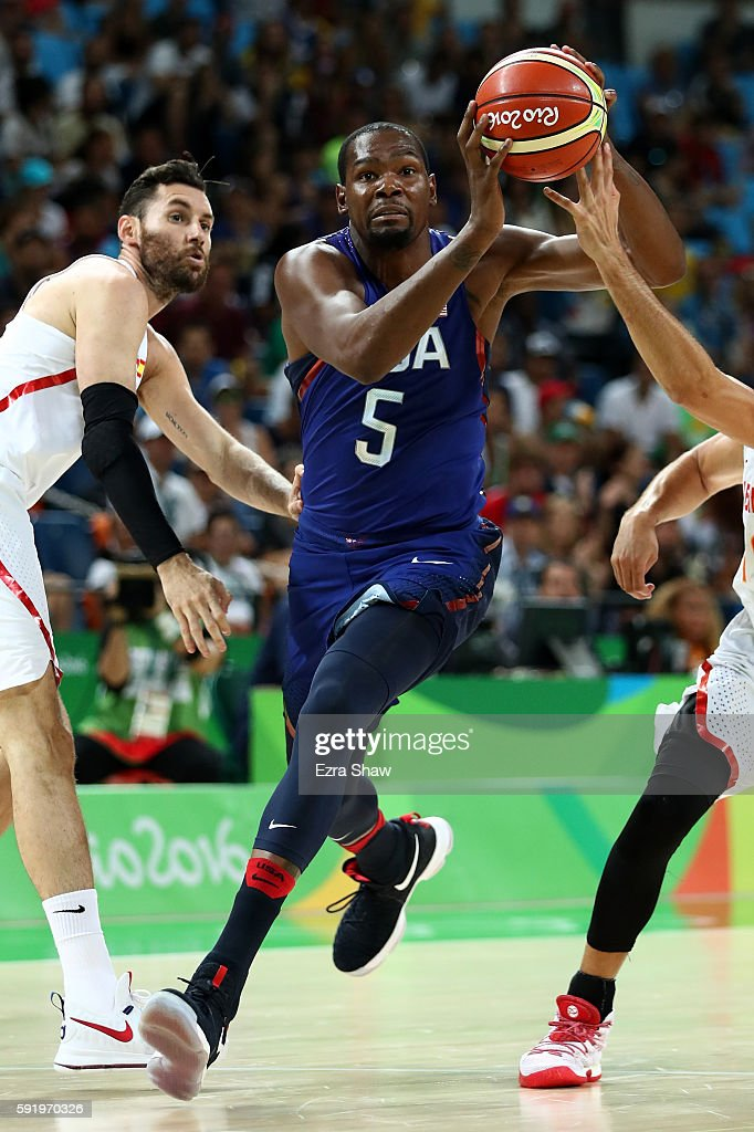Kevin Durant of United States goes to the basket against Rudy Fernandez of Spain during the Men's Semifinal match on Day 14 of the Rio 2016 Olympic...