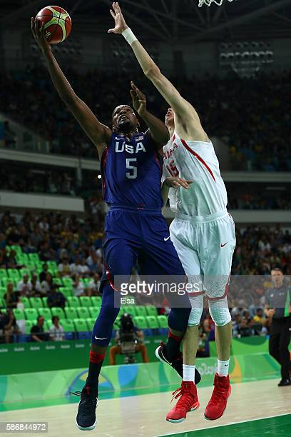 Kevin Durant of United States shoots over Qi Zhou of China in the Men's Preliminary Round Group A match on Day 1 of the Rio 2016 Olympic Games at...