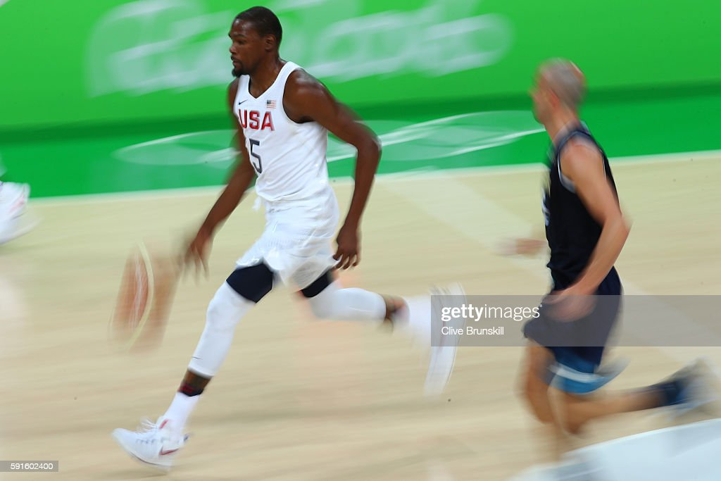 Kevin Durant #5 of United States with the ball against Manu Ginobili #5 of Argentina during the Men's Quarterfinal match on Day 12 of the Rio 2016 Olympic Games at Carioca Arena 1 on August 17, 2016 in Rio de Janeiro, Brazil.