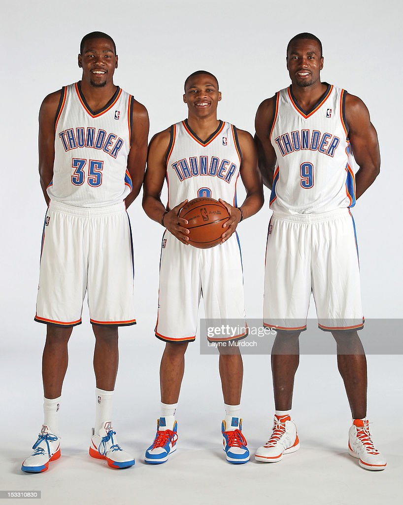 Kevin Durant #35, Russell Westbrook #0 and Serge Ibaka #9 of the Oklahoma City Thunder pose for a portrait during 2012 NBA Media Day on October 1, 2012 at the Thunder Events Center in Edmond, Oklahoma.